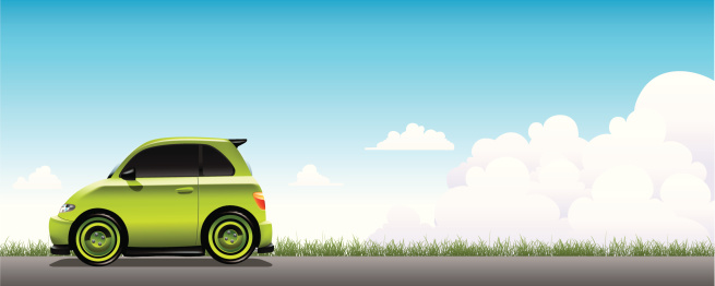 Vector illustration of a small green car on a gray road