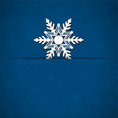 A vector illustration of a white colored snow flake slid into a slit over dark midnight blue color xmas background