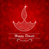Vector illustration of an illuminated Diya. A reddish maroon vibrant Deepawali background with twinkle on the Deepak and flame. The Diya and flame are made up of small dots glitter. There are small glittery in red, maroon. Traditional Indian festival, Diwali is celebrated by lighting Diyas or Deepaks. Happy Diwali is written within two lines and a swirl design at the bottom. The Diya is in the centre.