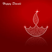 Vector illustration of an illuminated Diya. A reddish maroon vibrant Deepawali background with twinkle on the Deepak and flame. The Diya and flame are made up of small dots glitter. There is reflection of the Diya at its base. Traditional Indian festival, Diwali is celebrated by lighting Diyas or Deepaks. Happy Diwali is written at the top left. The Deepak is in bottom right.