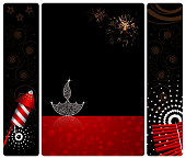 "Vector illustration divided into three vertical bands. The extreme left and right bands are smaller in size and are equal in width. The middle or central band is wider than the adjoining bands. All three bands have curved or rounded corners and separated by small white borders. The left most band has a lighted red and white rocket sparkler over black background with orange reddish swirls and twrirls and stars.The middle band has a lighted Diya on black colored Deepawali background with twinkle on the Deepak . The Diya and flame are made up of small white dots glitter. The bottom of middle band is bright red gradient background with dreamy dots. The right band  is a lighted firecracker bunch also called as 'Lari' or ""Ladi"" in Hindi.The black sky is illuminated with sky sparklers.There is a reflection of the Diya at its base. The black sky is illuminated with sky fire sparklers."