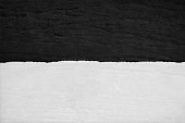 Horizontal vector illustration of black and white wooden textured background. The abstract wallpaper is like a layer of snow over a black surface. There is ample space for copy text and no people, no text.