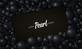 Vector illustration of card placed in black pearls or spheres. Volumetric randomly distributed balls. Surface constructed from black balls background. Luxury card mockup, template.