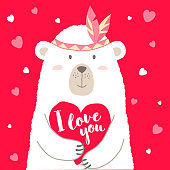 Vector illustration of cute cartoon bear holding heart and hand lettering I love you  for valentines card,  placards, t-shirt prints, greeting cards.