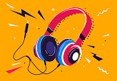 Vector illustration of headphones with a plug and decorative elements around