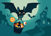 Vector illustration of nighttime Halloween scene, cute bat flying with bucket full of candy, with full moon, haunted house, forest cemetery in the background. Flyer, banner, poster or card template.
