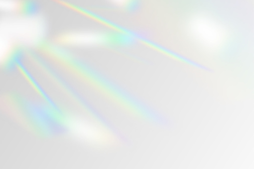 Vector illustration of rainbow flare overlay effect mockup. Blurred reflection crystal rays, shadows and flash on background. Natural iridescent light backdrop