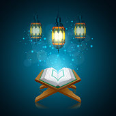 vector illustration of Ramadan Kareem beautiful greeting card with traditional Arabic lantern on blurred blue background