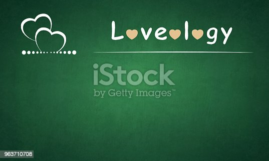 Vector Illustration of two hearts on a green board. Underlined word Loveology written on the board with pink hearts in place of O's . The green board is grunge.The hearts are underlined by a pattern of dots. The size of the dots decreases towards the middle and then again increases towards the end. It appears to be a board of a class / lecture on Love / Loveology.