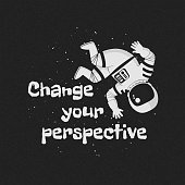 """Vector illustration, poster, t-shirt design with the text """"Change your perspective"""". Monochrome cartoon astronaut floating upside down and waving hand with stars on a dark background."""