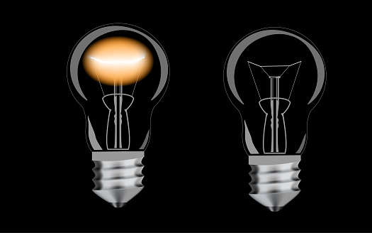 Vector illustration. Realistic illuminated incandescent lamp on a black background.