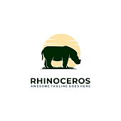 Vector Illustration Rhinoceros With Sunset Silhouette Style.