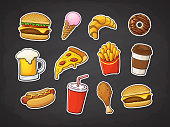 istock Vector illustration. Set of fast food. Pizza slice, burger, hot dog, cheeseburger, French fries, donut, Fried chicken leg, beer, ice cream, croissant, paper cup of soda, coffee. Stickers with contour 1067016678