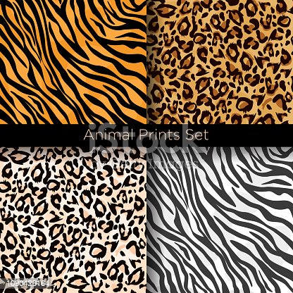 Vector illustration set of four different seamless animal patterns. Safari textile concept. Tiger, zebra, leopard and jaguar skin seamless patterns in flat style for your design