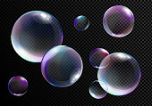 Vector illustration set of realistic bright soap bubbles with rainbow colors on transparent black background