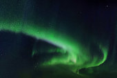 Abstract colorful background with green aurora borealis