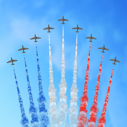 Vector illustration with nine planes and trails in blue white and red colors of the flag of France or USA.