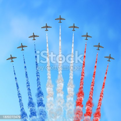 istock Vector illustration with nine planes and trails in blue white and red colors of the flag of France or USA. 1320272479