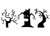 istock Vector illustrations of black tree silhouettes on white background. Drawn by hand doodle halloween scary trees for spooky decorations. 1267387848