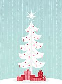 A retro-styled Christmas tree, decorated with ornaments and a star, and brightly packaged gifts underneath.