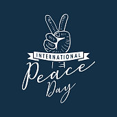 Vector International Peace Day with hand drawn hand sketch drawing. Popular lettering calligraphy illustration isolated on blue background.