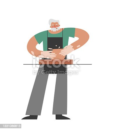 istock Vector isolated flat illustration with senior Caucasian man working at pottery wheel. Old student learns to make ceramic pot. Hands and apron of craftsman are stained with clay. Hobby 1331086813