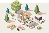 Vector isometric low poly caravan trailer and camping equipment