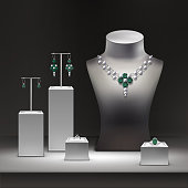 Vector illustration of jewelry shop and set of jewelry on display in showcase