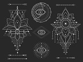 Vector kit of Sacred geometric and natural symbols on black background. Abstract mystic signs collection. White linear shapes. For you design or modern magic craft.