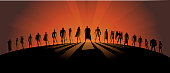A silhouette style illustration of a big team of varied superheroes. Wide space available for your copy.