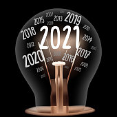 Vector Illustration of single light bulb with fiber in a shape of New Year 2021 and years passed isolated on black background.