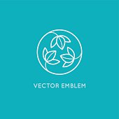 Vector logo design template and emblem made with leaves and flowers - badge for yoga studios, holistic medicine centers, natural cosmetics, handcrafted jewelry and organic food products
