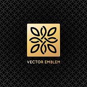 Vector logo design template and emblem  with leaves and lines - luxury beauty spa concept - golden badge for yoga studios, holistic medicine centers, natural and organic food products and packaging