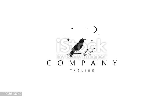 istock Vector logo on which an abstract image of a raven sitting on a branch. 1203613740