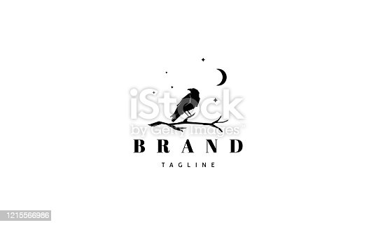 istock Vector logo on which an abstract image of a raven sitting on a branch under the moon. 1215566986