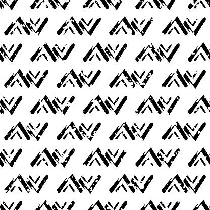 Vector loose tribal zig zag grunge seamless pattern background. Painterly brush stroke chevrons ethnic black and white backdrop. Geometric design. All over print for packaging, stationery.