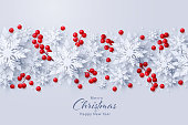 Vector Merry Christmas and Happy New Year background with realistic looking paper cut 3d snowflakes and red holly berries decoration. Seasonal holidays banner