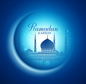 Vector Moon and Mosque Lightning in Dark Background with Ramadan Kareem Greetings. Silhouette Vector Illustration
