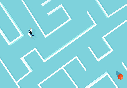 Vector of a businessman walking in a complex maze towards his target