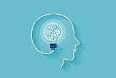Human intelligence concept. Vector of a human head with idea light bulb inside made of gear mechanisms