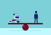 Vector of an educated businessman balancing stack of books on blue background