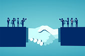 istock Vector of businesspeople reaching an agreement after successful negotiations 1134270327
