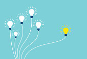 Vector of light bulbs on blue background. Business teamwork and one different opinion vision creative concept.