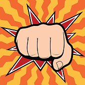 Vector of punching hand with a clenched fist aimed directly