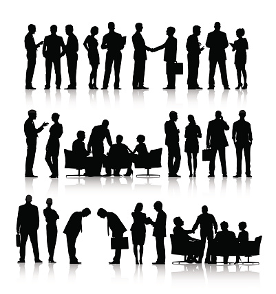 Vector of Silhouettes of Business People Working