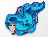 Vector paper portrait of young beautiful woman mermaid with long wavy hair. Paper underwater sea life with fishes, coral reef, seabed in algae, waves. Paper cut style vector. Deep blue marine life, diving concept. Ocean wildlife