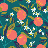 Vector seamless pattern with branches of oranges in bloom
