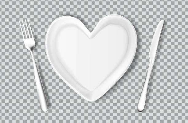 Vector plate in shape of heart, knife, fork Realistic plate in shape of heart, knife, fork. Valentines day romantic kitchenware, love and care symbol. Ceramic utensil, holiday evening celebration. Vector illustraiton on transparent background serving dish stock illustrations