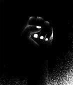 vector poster background. Human hand fist pointing up. Protest against racism. Black and white illustration with style texture effect.