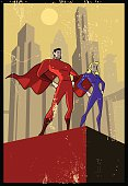 A propaganda style illustration of a superhero couple standing on top of a building with a retro themed city skyline in the background. Objects are layered and grouped for ease of editing.